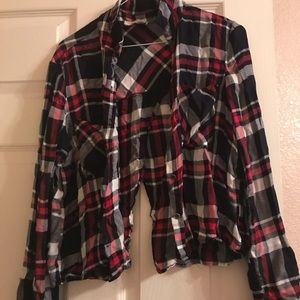Red, black, and white plaid shirt